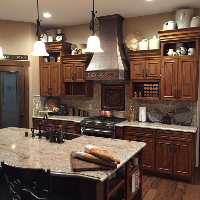 West Construction crafted this dream kitchen in this lake home with an open floor plan and granite countertops