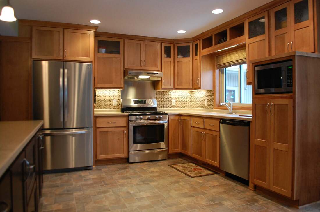 West Construction kitchen renovation tile floor, mosaic glass tile backsplash, stainless steel appliances, oak cabinetry