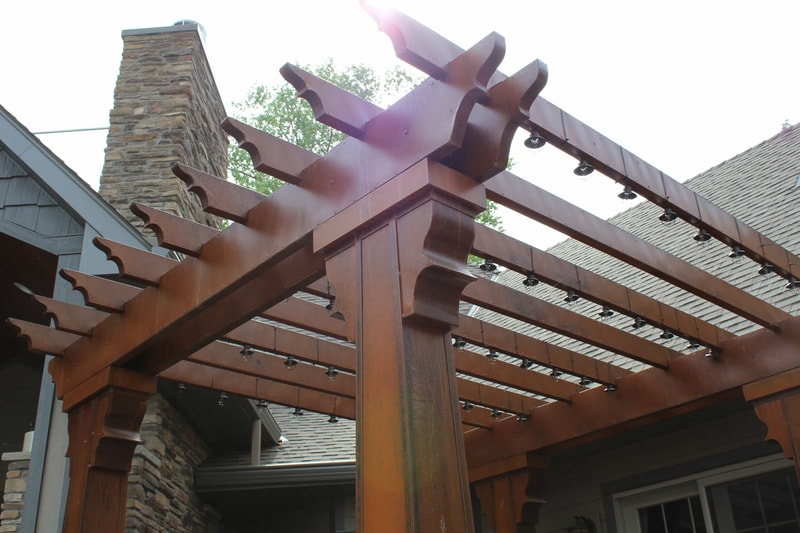 West Construction built this patio and pergola out back to enjoy the lakeview from this custom built home