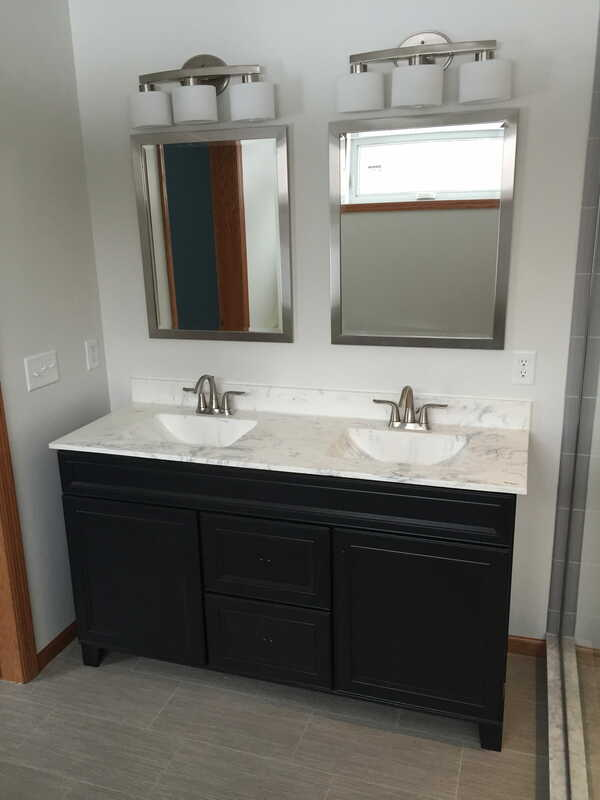 Bathroom built by West Construction - granite vanity with built in granite sinks, nickel accents and hardware, black vanity base, double sinks